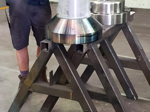 heated metal flange being pressed onto cold shaft