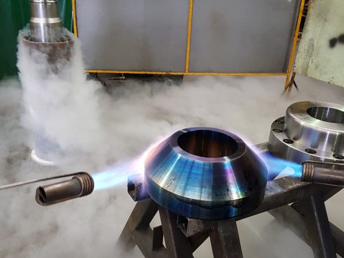 heating metal flange for metal machining brisbane