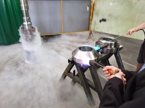 heating metal flange for metal machining brisbane